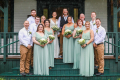 Wedding party standing on the front steps at Irondequoit Inn