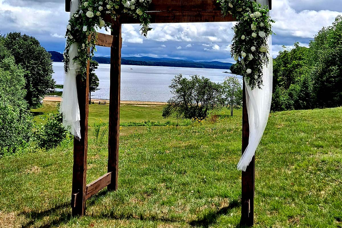 Wooden archway with views of lake
