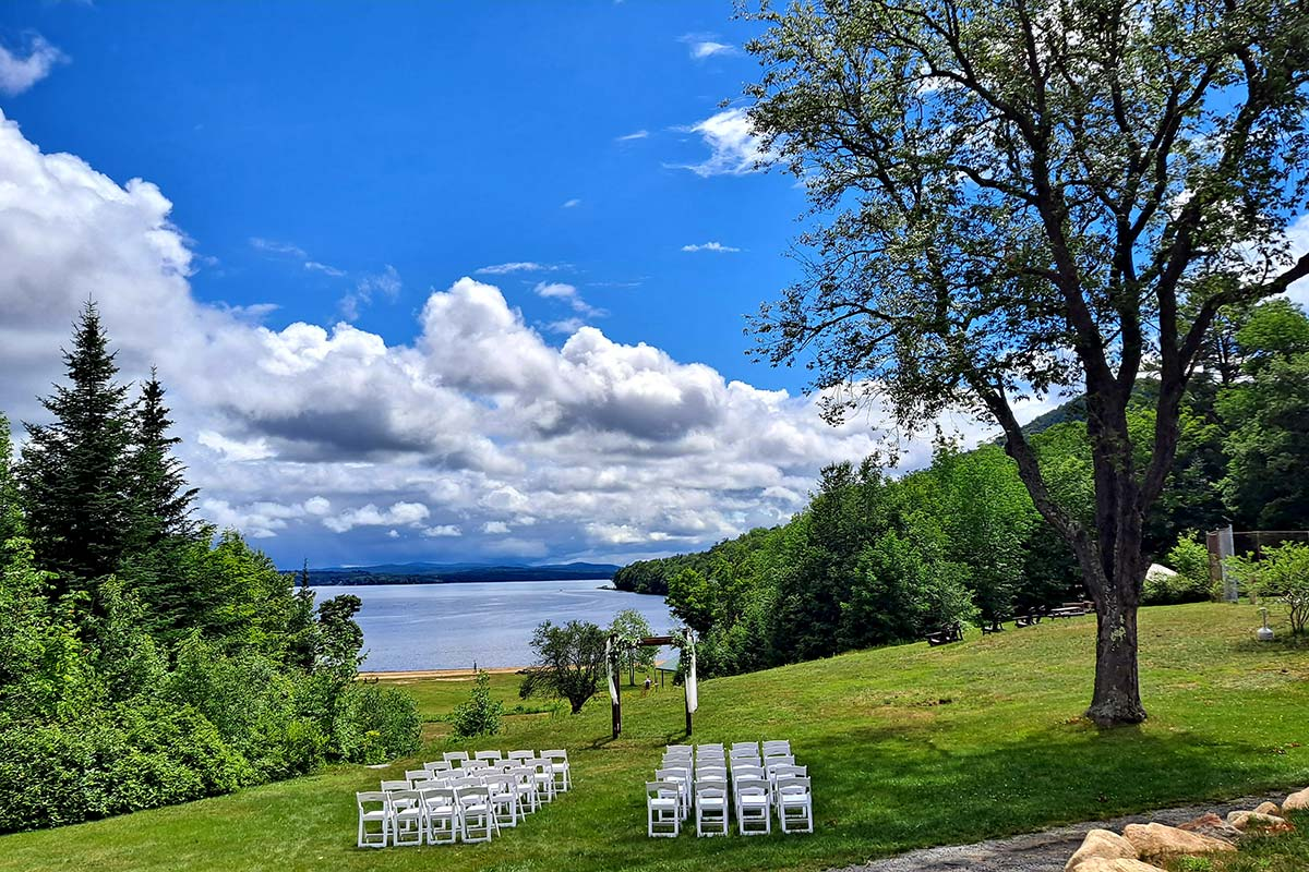 Lawn wedding with views of lake
