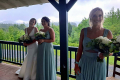 Bride and bridesmaids standing on porch