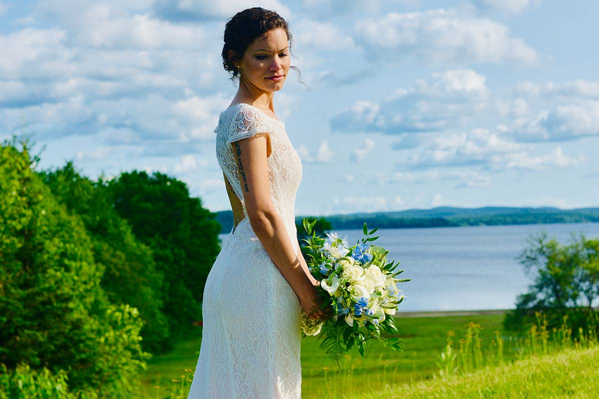 Bride posing in front of lake view