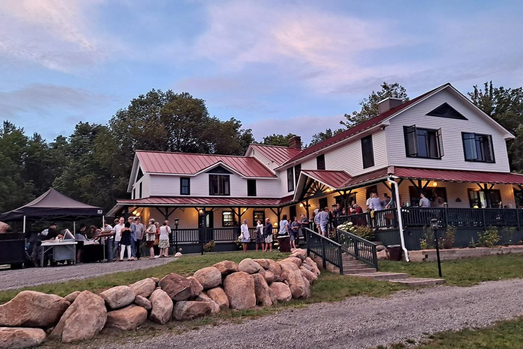 Large group event on the porch of Irondequoit Inn